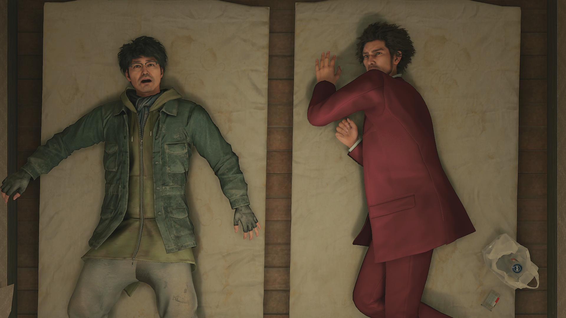 Scene from Yakuza: Like a Dragon, an RPG from SEGA. Ichiban and Nanba are sleeping on futon.